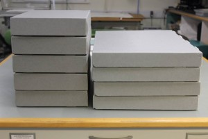 Fig 13: The manuscript fragments and bindings conserved, housed and pack in archival boxes, ready to be returned to the University Library.
